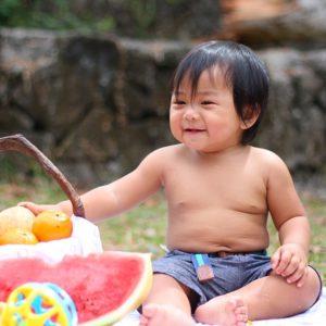 Baby eating healthy snacks